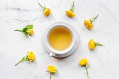 Spring flatlay with flowers and cup of tea top view Royalty Free Stock Image