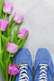 Spring flatlay sports composition with blue sneakers and purple Stock Photography