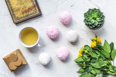 Spring flatlay on white marble work desk background top view Royalty Free Stock Photography