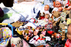 Spring flea market. Colorful flea market booth offering toys and dolls stock image