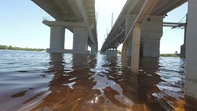 Spring . Flood. descent to the water under the bridge. Spring . Flood. descent to the water under the bridge stock footage