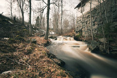 Spring flood running past old smeltery Stock Photography