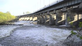 Spring flood water flowing on hydroelectric power station dam stock footage