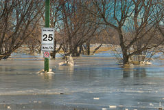 Spring Flooding. Selkirk, Manitoba, Canada.  The worst ice jam in local history causes flooding, closing Selkirk Bridge over Red River, flooding highway and Royalty Free Stock Photos