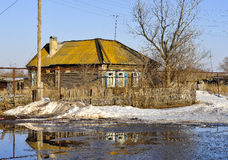 Spring floods. Country house, surrounded by a large puddle of water Royalty Free Stock Images
