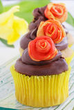 Spring floral cupcakes Stock Photos
