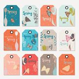 Spring floral gift tag design, with hand drawn flowers, floral elements, vases and monarch butterflies Stock Images