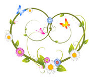 Spring floral heart. Made from flowers and butterflies Stock Photos
