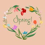 Spring floral heart with colorful flowers Stock Photos