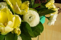 Spring flower arrangement in a green wooden box, tulips, eustoma.  Royalty Free Stock Photos