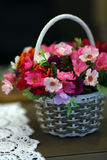 Spring flower basket. On taple Royalty Free Stock Images
