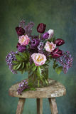 Spring flower bouquet. Rustic style. Coated colored texture Stock Photography