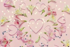 Spring flower composition and hearts in center. Spring love greeting. Top view, flat lay.  Stock Images