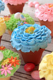 Spring flower cupcakes in pots. Royalty Free Stock Photography