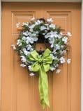 Spring flower wreath on door Stock Images