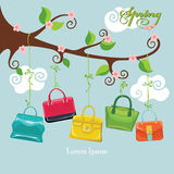 Spring  flowering branch and colored handbags Stock Photo