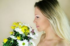 Spring flowers. Portrait of a fresh, beautiful young blond woman with some flowers in her hand - valentine ´s day Stock Images