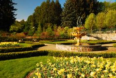 L:adson Park, New York. Spring Flowers bloom around a fountain in Ladson Park, in Westchester County, New York royalty free stock image