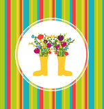 Spring flowers in boots Royalty Free Stock Photo