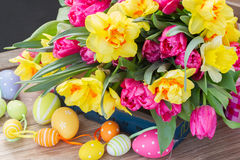 Spring flowers bouquet with easter eggs Stock Photos