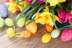 Spring flowers bouquet with easter eggs Stock Image