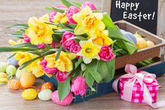 Spring flowers bouquet with easter eggs Stock Photo