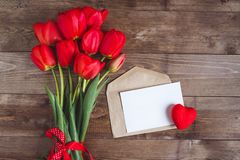 Spring flowers. Bouquet of Red tulips on brown wooden background. Royalty Free Stock Photos