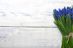 Spring flowers bouquet on wooden table. Top view, copy space. Stock Image