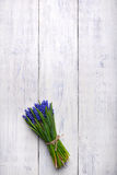 Spring flowers bouquet on wooden table. Top view, copy space. Royalty Free Stock Image
