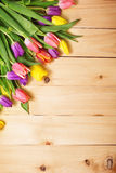 Spring Flowers bunch at wood floor texture. Beautiful Tulips bou Royalty Free Stock Photos