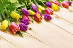 Spring Flowers bunch at wood floor texture. Beautiful Tulips bou Royalty Free Stock Image