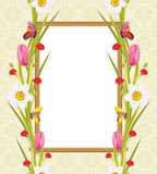 Spring flowers and butterflies in the decorative frame. Greeting card Stock Photo