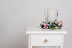Spring flowers with candle Stock Images