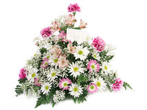 Spring Flowers With Card. A beautiful arrangement of spring flowers with a blank card Royalty Free Stock Images
