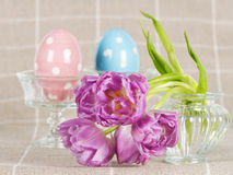 Spring flowers with ceramic eggs Royalty Free Stock Photos