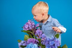 Spring flowers. Childhood. Childrens day. Small baby boy. New life concept. Spring holiday. Summer. Mothers or womens. Day. Little boy at blooming flower. Great stock photos