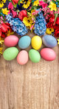 Spring flowers and colored eggs. Easter decoration Royalty Free Stock Images