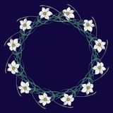 Spring flowers. Daffodil flowers interlaced into an intricate circular ornament on a dark blue background. Art Nouveau. Style drawing. Mandala tattoo design Stock Photo