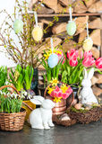 Spring flowers with easter bunny, eggs decoration. Spring flowers with easter bunny and eggs decoration. tulips, snowdrops and narcissus blooms on white Royalty Free Stock Images