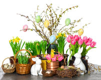 Spring flowers with easter bunny and eggs decoration. Tulips, snowdrops and narcissus blooms on white background Stock Photography