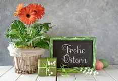 Spring flowers, Easter decorations and a blackboard on white tab Royalty Free Stock Photography