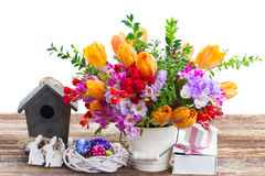Spring flowers with easter eggs Stock Photos