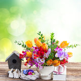 Spring flowers with easter eggs Royalty Free Stock Photos