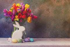 Spring flowers with easter rabbit and eggs Stock Photos