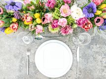 Spring flowers table place setting floral decoration. Spring flowers. Festive table place setting with floral decoration Royalty Free Stock Image