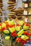 Spring flowers in the foreground. A bouquet of artificial tulips stands in a wicker basket stock image