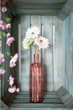 Spring gerbera flowers in a vintage pink vase Stock Image