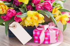 Spring flowers with gift box and empty tag Stock Images