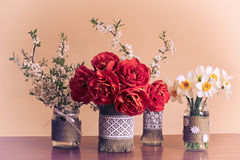 Spring flowers in glass jars. Spring flowers in decorated glass jars stock photography