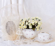 Spring flowers in a glass teapot Stock Image
